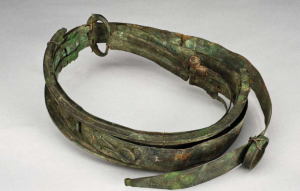 A bronze and leather thigh tourniquet used by the ancient Romans to control bleeding.